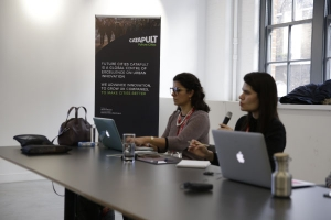 Brazilian interpreters doing simultaneous interpreting at Future Cities Catapult with tour guide in London UK
